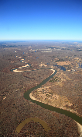 Aerial view of meandering river with oxbow lake in Texas