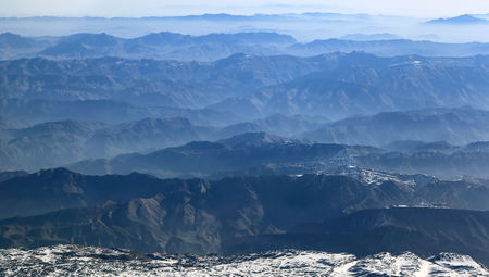 Aerial view of mountain ranges receding to the horizon