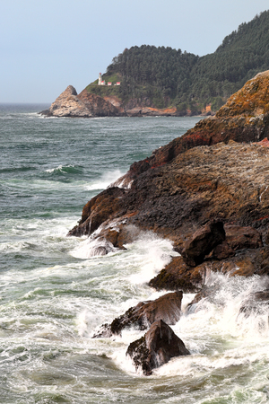 Heceta Head Lighthouse and seascape, Oregon Stock Photo
