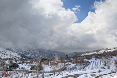 Mountains with Faqra Roman Ruins in the Snow, Lebanon Stock Photo