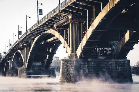 The stone bridge on the misty River