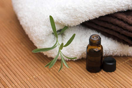 Holistic & aromatherapy oil with lavender & towel - focis around the lavender