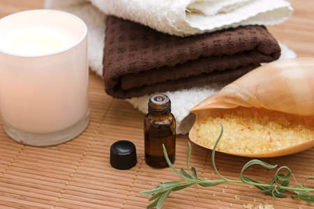 Holistic therapy set, focus around the oil bottle photo
