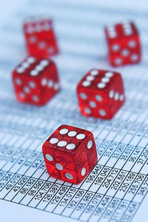 Casino/poker dice & financial data - shallow depth of field, focus around closest die Standard-Bild