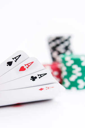 Four aces & a stack of casino chips - its a winning combination! Shallow dof on white photo