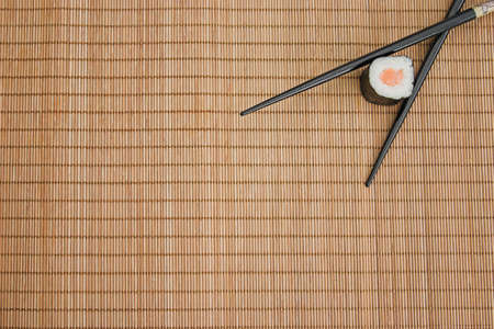 Sushi & chopsticks on a bamboo mat Stock Photo
