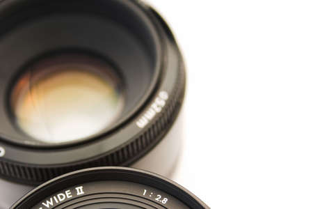 deliberate: Close up of two SLR lenses - deliberate focus with intentional copy space to the right Stock Photo