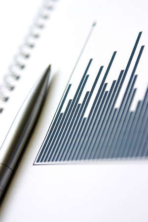 Column graph & silver pen - shallow depth of focus, grain on the graph columns is due to the print on paper Stock Photo