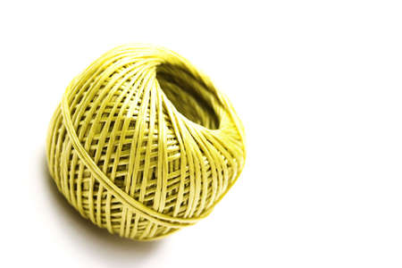 nylon string: Isolated ball of yellow nylon string - slight shadows Stock Photo