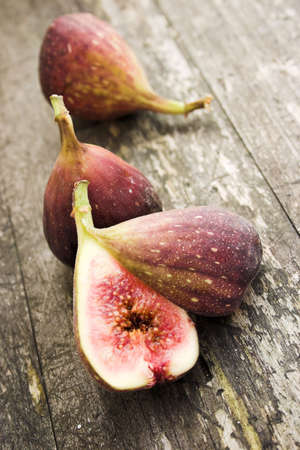 Sliced figs on a wooden background - shallow depth of field