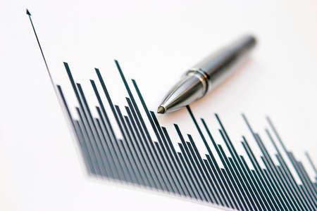 Generic graph & silver pen - shallow depth of field & slight grain Stock Photo - 707020