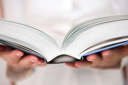 An open study book being read - shallow dof