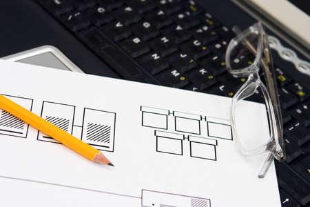Network design draft on a laptop keyboard - shallow depth of field