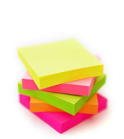 Isolated multi coloured post it notes stacked up - shallow dof Stock Photo