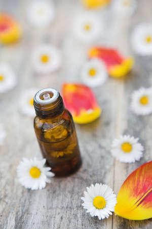 Close up of aromatherapy oil & petals - shallow dof