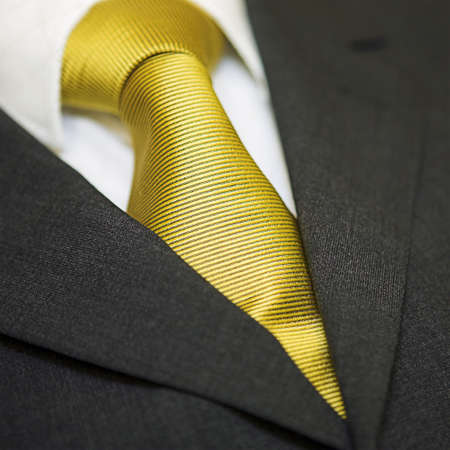 Close up of gold tie, shirt & suit - shallow depth of field Stock Photo