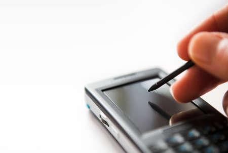 Close up of PDA & hand inputing data - shallow dof Standard-Bild
