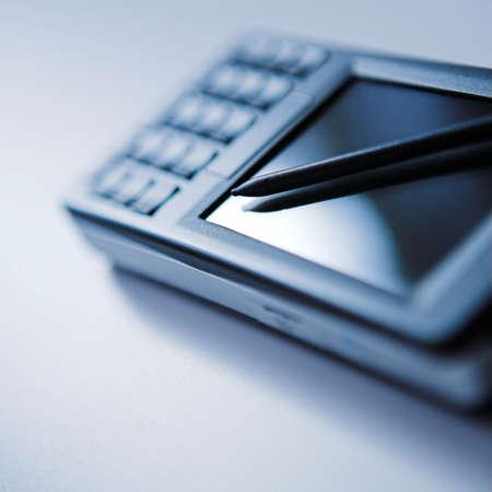 Close up of a PDA & stylus, deliberately stark image- shallow dof