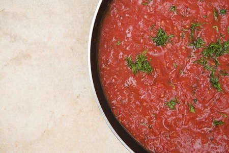 Sauce pan with homemade tomato & herb pasta sauce - copy area to left