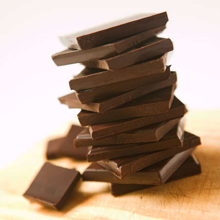 Blocks of chocolate stacked up - shallow dof