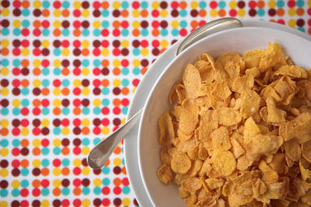 Bowl of cornflakes on a coloured tray