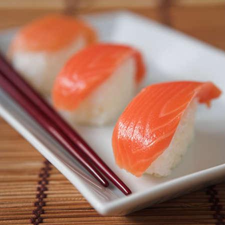 tekka: Close up of sushi & chopsticks - shallow dof