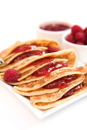 Pancakes with raspberry jam & fresh raspberries - shallow dof