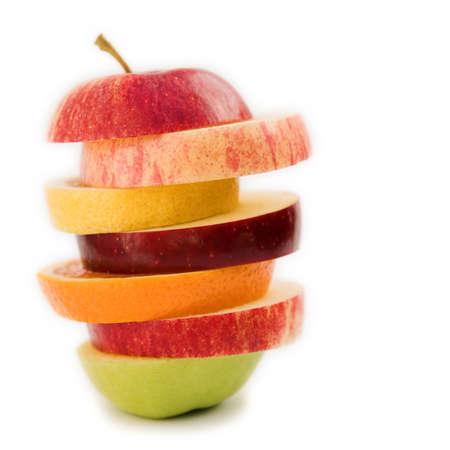 Apple comprising of sliced fruits (orange, lemon & apple) healthy eating idea - isolated on white Standard-Bild