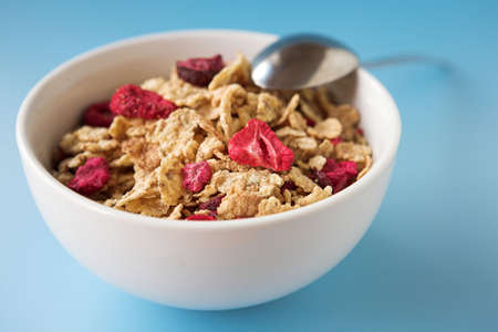 Close up of cereal & fruits on a blue  background - shallow dof Standard-Bild