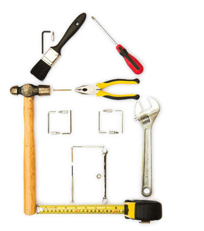 Selection of tools in the shape of a , home improvement concept - isolated on white photo
