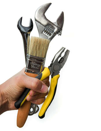 Hand holding a selection of tools, repairman concept - isolated on white Standard-Bild