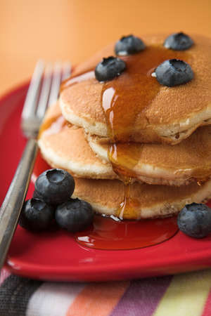 dollop: Blueberry pancakes & maple syrup - shallow dof Stock Photo
