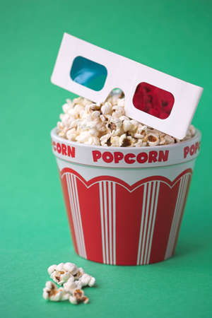 3D glasses & a bucket of popcorn - 3D cinema concept, shallow dof photo