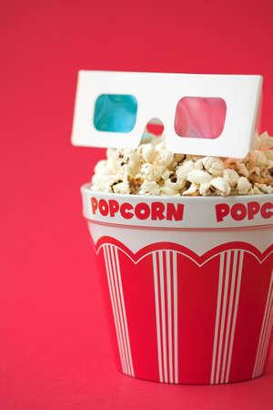 3D glasses & a bucket of popcorn - 3D cinema concept, shallow dof photo