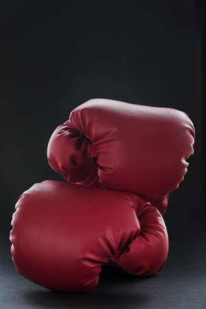 Red boxing gloves on black Stock Photo