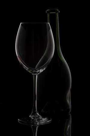 Wine glass & bottle on black