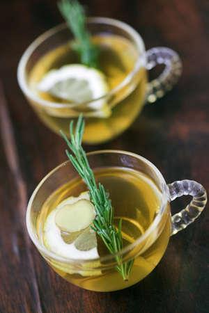 ginger tea: Lemon, ginger & rosemary herbal tea - shallow dof
