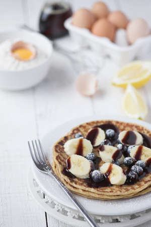Freshly prepared crepes with banana & chocolate sauce - shallow dof