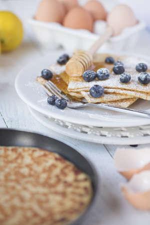 Freshly prepared crepes with blueberries - shallow dof Standard-Bild