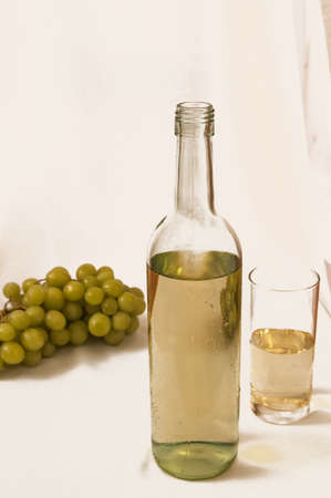 White wine and grapes photo