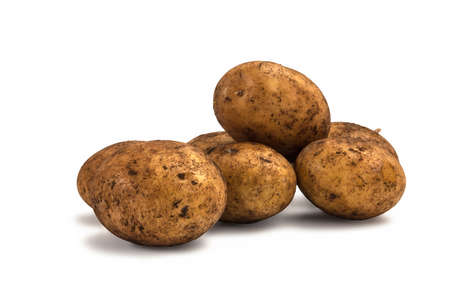 whote: Potatos ready for cooking laying on whote background