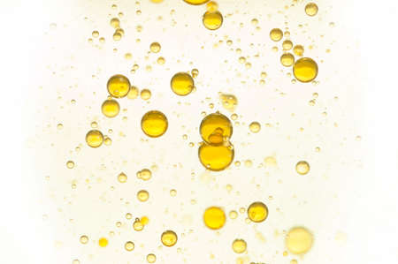 Yellow gas bubbles rising toward the surface Standard-Bild
