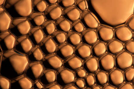 boils: Beautiful golden brown brass surface with many bubbles Stock Photo