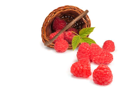 willow fruit basket: Basket with nice red raspberries over a white background Stock Photo
