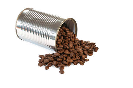 toppled: Coffee beans rolling out of a toppled tin can Stock Photo