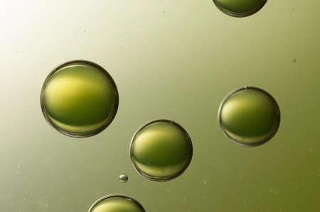 Some big air baallon flying over a light green background.. Standard-Bild