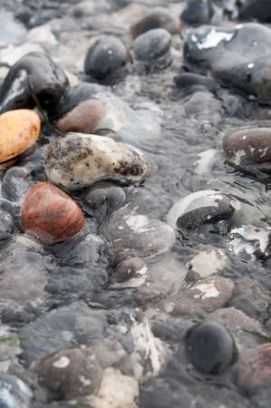 seawater: Seawater flowing in stone on the beach Stock Photo