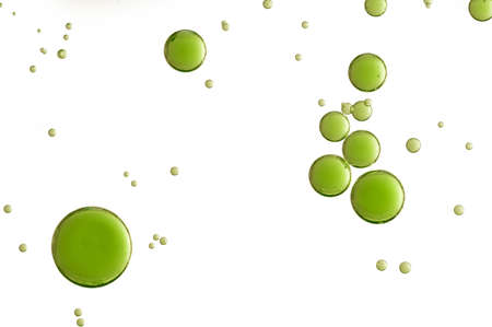 dissolved: Green acid bubbles over a white background Stock Photo