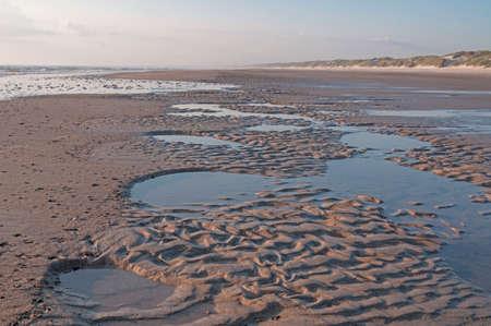 beautifu: A beautifu sunny beach waiting for the tide