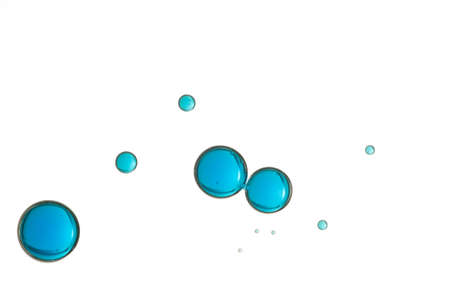 Beautiful blue air bubbles soars over a white background